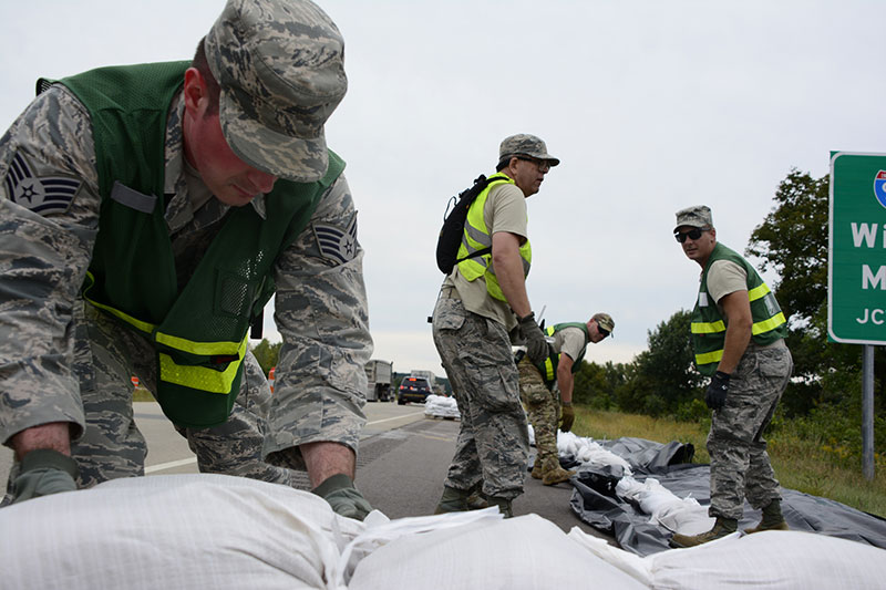 Members of the 115th Fighter Wing provide support by placing sand bags during summer flooding in southern Wisconsin in 2018